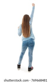 Rear view or back of an girl arms up happy jumping, full length standing. Isolated on white background
