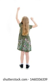 Rear view or back of happy little girl arms up, full length standing. Isolated on white background.