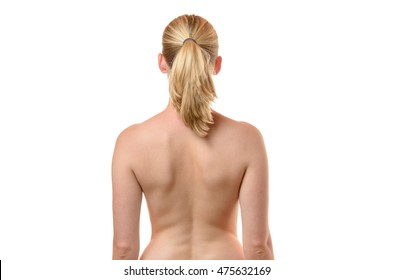 Rear view of the bare back of a curvy shapely young woman with her arms to her side, close up cropped upper body view isolated on white