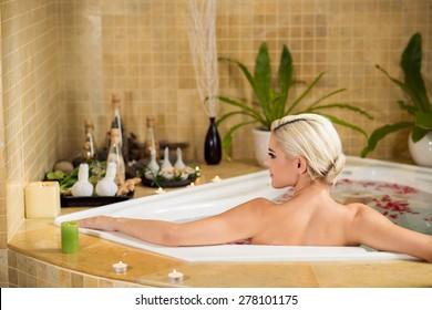 Rear view of beautiful woman taking bath