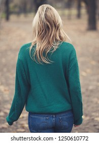 Rear view of blonde woman enjoy walking at public park