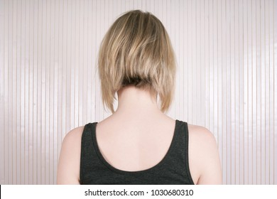 rear view of a blonde woman with lob or long bob haircut