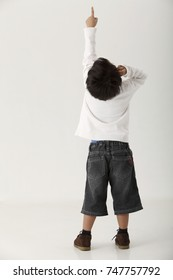 Rear View of a Boy pointing up