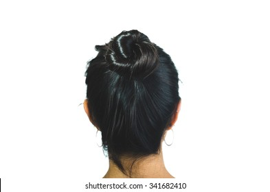 Rear view of brunette girl with hair bun isolated on white