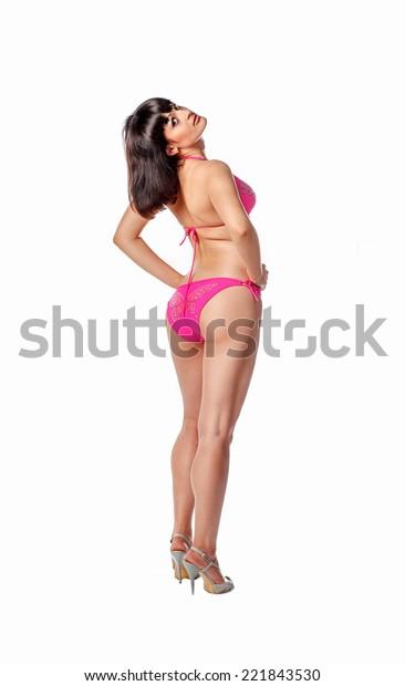 Rear view of brunette women in pink bikini full body shot
