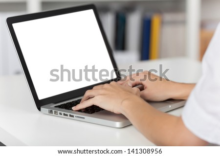 Rear view of business woman hands busy using laptop at office desk, with copyspace