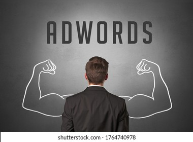 Rear view of a businessman with ADWORDS inscription, powerfull business concept