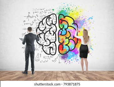 Rear view of a businessman and a businesswoman drawing a colorful large brain sketch on a concrete wall. Concept of creativity and tactics in business