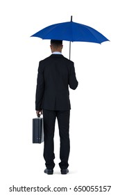 Rear view of businessman holding blue umbrella and a briefcase against white background
