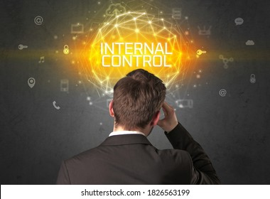 Rear view of a businessman with INTERNAL CONTROL inscription, online security concept