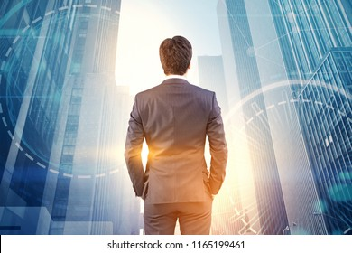 Rear view of a businessman looking at a modern cityscape. An immersive interface hologram with a global network. Toned image double exposure. Elements of this image furnished by NASA
