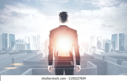 Rear view of a businessman looking a white maze. A morning city background. Concept of hope and solution search in business and life. Finding your way. Toned image double exposure mock up
