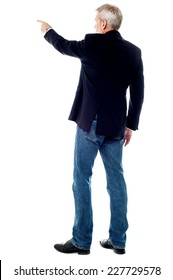 Rear view of businessman pointing at copy space