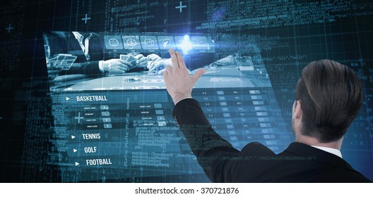 Rear view of businessman pointing with his fingers against blue matrix and codes
