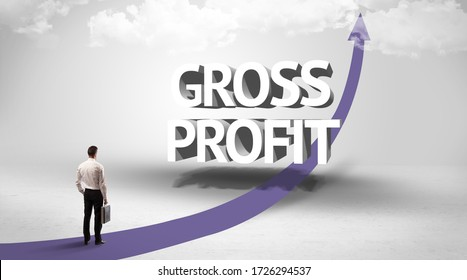 Rear view of a businessman standing in front of GROSS PROFIT inscription, successful business concept