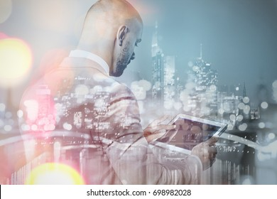 Rear view of businessman with tablet pc double exposure