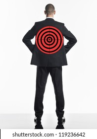 Rear view of a businessman with target over white background