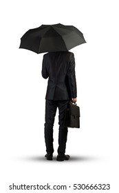 Rear view of businessman with umbrella isolated on white background