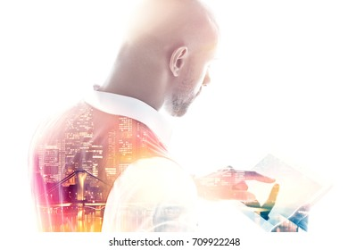 Rear view of businessman working on a tablet pc pointing his finger on the screen double exposure