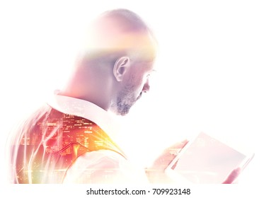 Rear view of businessman working on a tablet pc double exposure