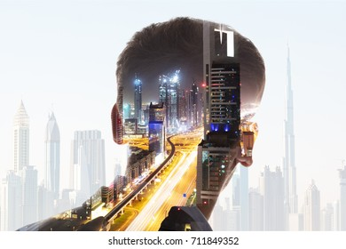 Rear View Of Businessman's Head With Illuminated Highway At Night