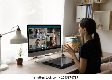 Rear view businesswoman chatting with colleagues online, business partners negotiations, using webcam and platform for group video call, students discussing project, participating in conference