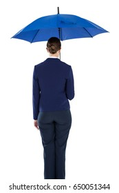 Rear view of businesswoman holding blue umbrella against white background