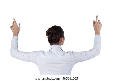 Rear view of businesswoman using digital screen against white background