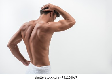 Rear view of charming muscular guy