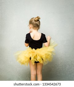 Rear view of a child girl wearing tulle tutu and leotard