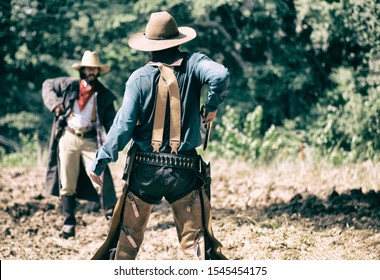 rear view of cowboy while standing on gunfight