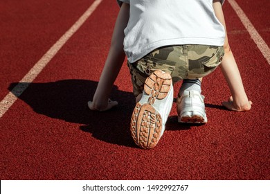 Rear view of a determined athlete ready to run on a treadmill. The concept of a sports lifestyle, training, sport, determination