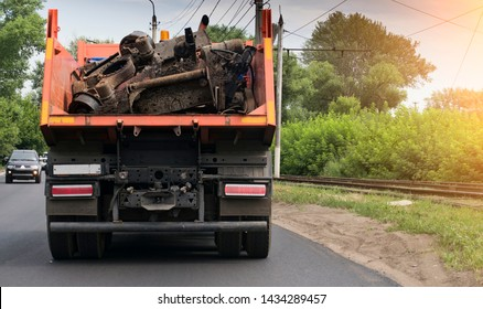 rear view of a dump truck loaded on the road laden with scrap metal