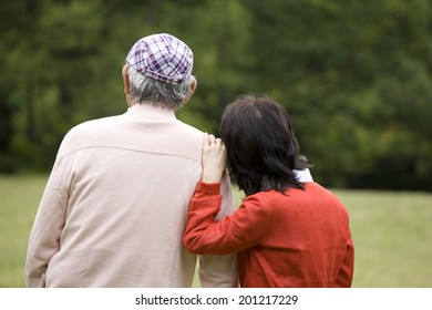 The rear view of the elderly couple sightseeing together