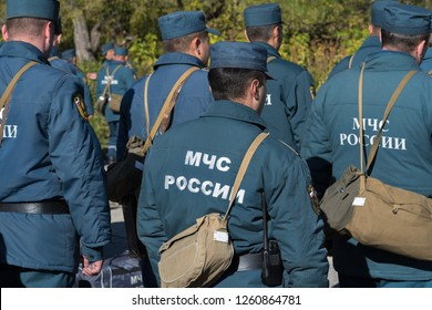 Rear view with Emercom of Russia emblem on uniform rescuers of Russian Federation for Civil Defence, Emergencies and Elimination of Consequences of Natural Disasters (MChS).