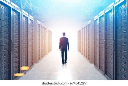 Rear view of an engineer standing in a server room with polygons hologram above him. 3d rendering mock up toned image double exposure