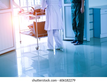 Rear view of a female nurse walking out.