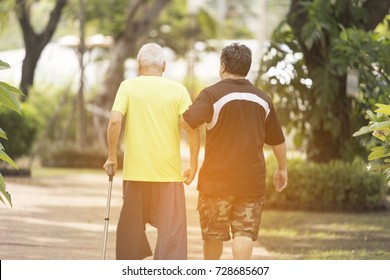 Rear view of Freelance Nurse take care senior man who has alzheimer's disease. Memory problem due to Dementia and disease as a medical health care concept with a brain scared or Father's Day.