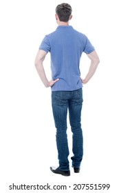 Rear view, full length shot of a young man looks ahead