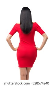 Rear view of gorgeous brunette in red dress posing on white background. Isolated.
