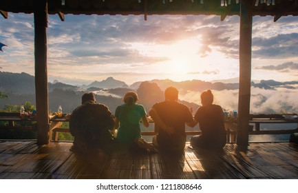 Rear view of group friends sitting together on mountain view in relax time,copy space.