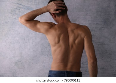 Rear view of handsome muscular man. Male Waxing
