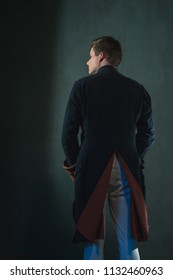 Rear view of historical empire man in jacket.