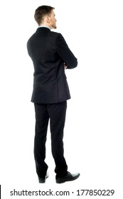 Rear view image of young male business executive
