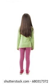 Rear view of little girl with long hair looking at wall. Isolated on white background