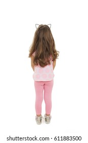 Rear view of little girl looking at wall. Isolated on white background