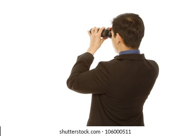 Rear view of a man in business attire using binoculars (on white)