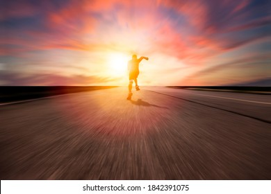 rear view man running and sprinting on the road with blur background