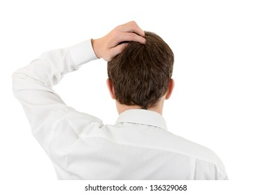 Rear View of Man Scratching his Head. Isolated on the white background