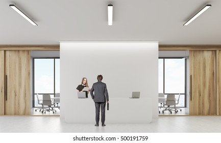 Rear view of man in suit talking to receptionist in office with wooden walls. Concept of business visit. 3d rendering. Mock up